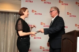 parker presented with a charity donation to the women in the director's chair program by afbs president bob underwood