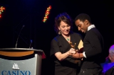Actress Jennie Raymond presenting Simon Paul Mutabazi with the ACTRA Maritimes award for his performance in the short Thug.