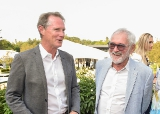 Steven DeNure and Norman Jewison chatting at the garden party.
