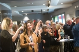 The audience raises their glass during the Indiescreen award ceremony