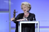 Shirley Douglas admires her latest statuette, the ACTRA Toronto Award of Excellence, presented to her at the 2013 ACTRA Awards in Toronto (photo: Jag Gundu)