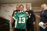 Retired Saskatchewan Roughriders present Kim Coates with their team sweater.