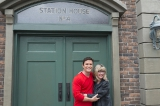 yannick bisson (det. william murdoch) and christina jennings (ceo, shaftesbury) pose in front of station house no. 4 at the murdoch mysteries fan event