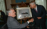 lieutenant governor of ontario david onley receives a gift from claude joli-coeur (nfb acting government film commissioner and chairperson),  a still from his the lieutenant governor's favourite nfb film, cosmic zoom