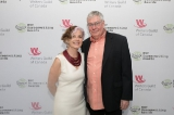 Diane and Peter Mohan posing for a photo at the WGC's 22nd annual screenwriting awards.