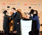 Jennifer Baichwal and Nicholas de Pencier announcing they will split the cash prize for the TFCA's Rogers award with nominees Sadaf Foroughi and Sofia Bohdanowicz.