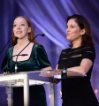Amybeth McNulty (Anne with an E) speaking at the podium with director/producer Amy Jo Johnson (Tammy's Always Dying).