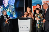 Pictured: Elle-Máijá Tailfeathers and Kathleen Hepburn accepting the TFCA's Rogers Best Canadian Film Award.