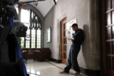Actor Kevin Gutierrez (Griffin) rehearsing a scene on set at Emmanuel College Library, University of Toronto