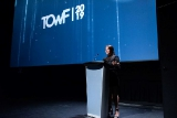 T.O. WebFest's Mariah Owen speaking at the podium during the festival's award ceremony.