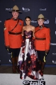 Emmanuelle Chriqui with a couple of Mounties on the red carpet