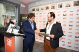 robert lantos presents hany ouichou with the cmpa's emerging producer award