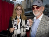 Presenter Norman Jewison and Lynne St. David show the results of their photo booth expedition (photo: Linda Dawn Hammond)
