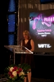 wift-t executive director, heather webb, on stage.