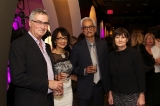 Martin Harbury, OMDC (to left); Lalita Krishna, Mentorship Award winner, and her husband, Ram Krishna , and guest  mingle at the reception.