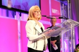 barbara bowlby accepting her outstanding achievement in business award at the 2014 wift-t crystal awards. credit: kowthar omar