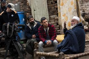 George interviews local Imam, Faisal Muhammed (R), in Kishawra, on 25 February, 2011, in the Swat Valley, Pakistan. The Taliban burnt down his family home, killing his 7 y/o daughter in the process, after her refused to submit to their rule and the townspeople rebelled.