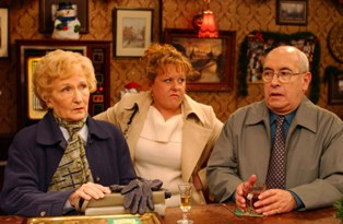 Coronation Street:  Monday 8 December 2003 at 7.30pm1/0694/5642Cilla Brown [Wendi Peters] reacts aggressively when  Norris Cole (MALCOLM HEBDEN) and Emily Bishop (EILEEN DERBYSHIRE)  complain  about her son, Chesney.DigitalNeil MarlandCopyright Granada Tv