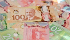 Copied from Media in Canada - money-pile_iStock-300x198