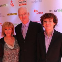 From Left:  Little Mosque on the Prairie's Deb McGrath, husband and host Colin Mochrie with their son Luc Mochrie