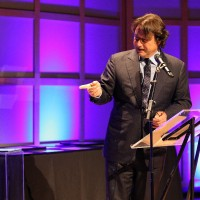 Producer and HOF presenter Robert Lantos admires the Swarovski award.