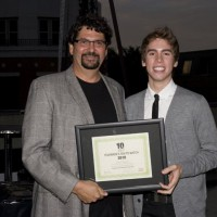 Panavision's Stewart Aziz presents the T2W award to Jordan Gavaris (photo: Linda Dawn Hammond)