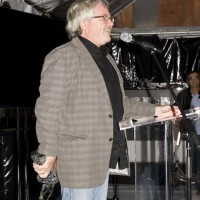 """Producer Kevin Tierney presents the Panavision Award to his son, director Jacob Tierney: """"I'm very proud to be his father and his producer."""" (photo: Linda Dawn Hammond)"""