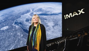 Toni Myers at IMAX theatre with A Beautiful Planet on-screen