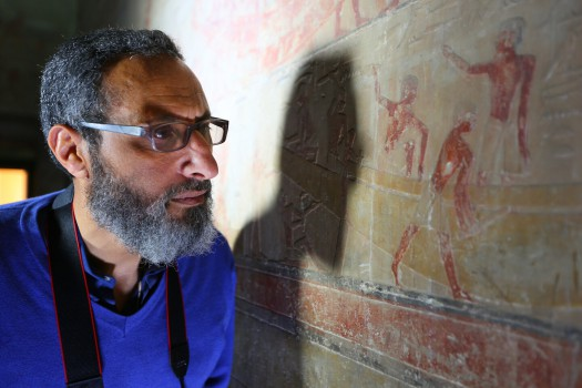 nautical archaeologist, mohamed abd el-maguid, examining markings on the wall as seen in lost secrets of the pyramid.